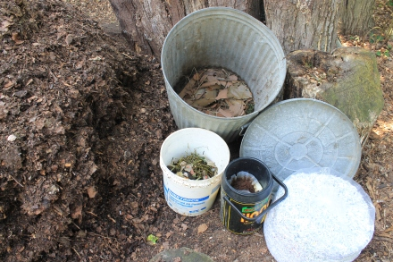 As my pile matures, new raw materials go into a garbage can -- a base of sycamore bark, shredded paper, food scraps and a dollop of compost...