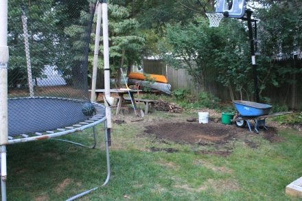 Digging out from under the trampoline makes it safer, and gives me a load of quality topsoil.