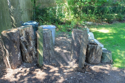 My pile now has a side door, fashioned by repurposing the wire screen I no longer use to sift compost.
