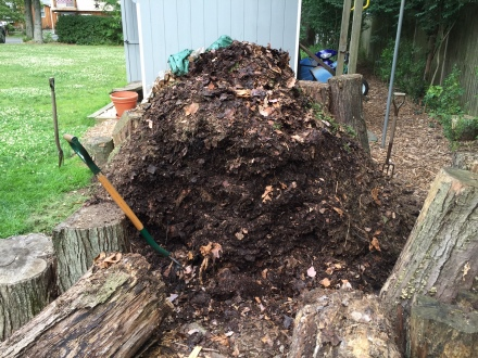 I've toppled the log walls that contain my pile to gain access to the right side.